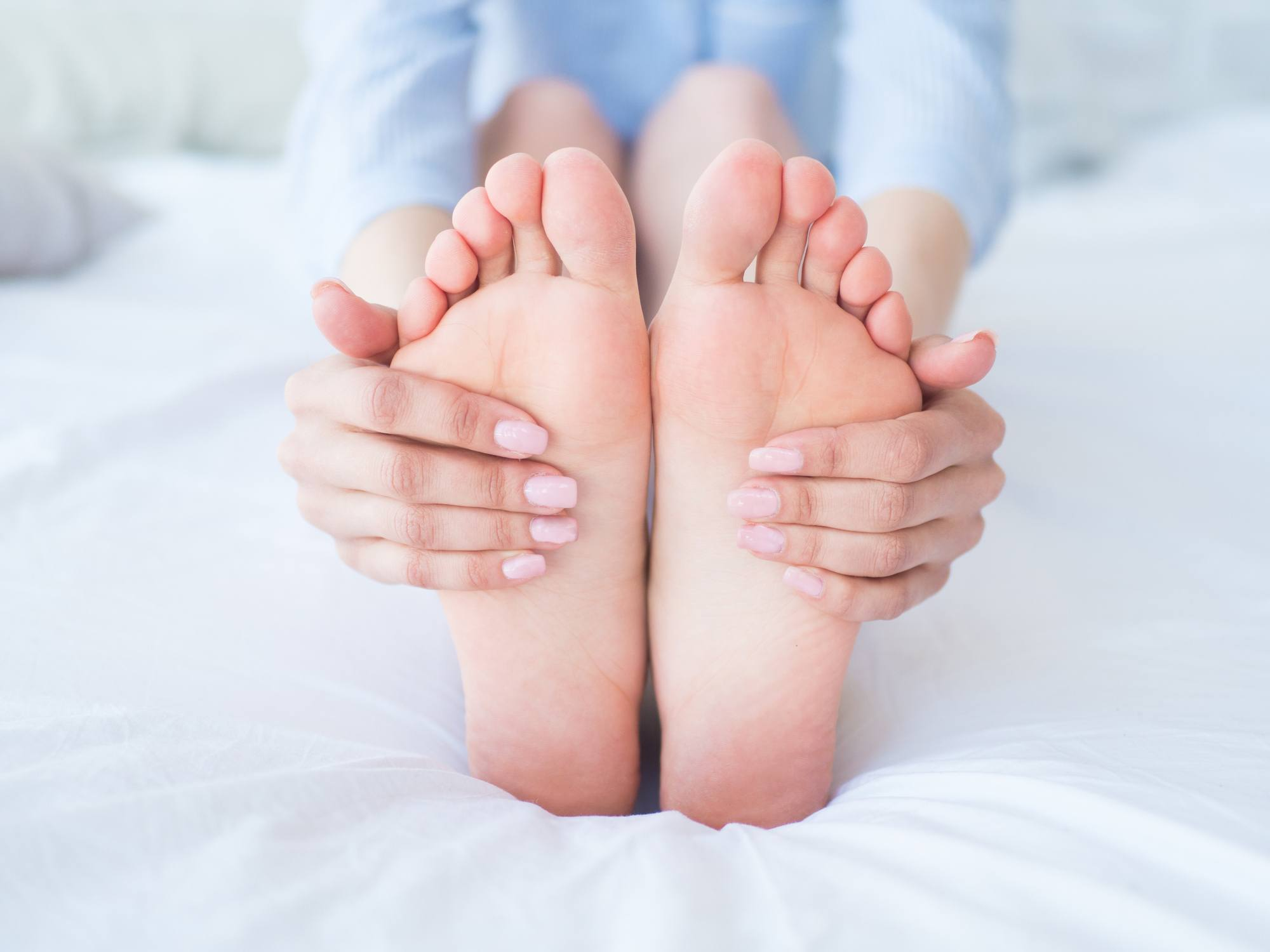 Horizon Foot & Ankle in St. Louis, MO - woman holding clean, healthy feet.